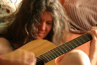 photo of Mary Shapiro playing guitar