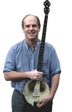 photo of Tom Rawson holding his banjo and smiling