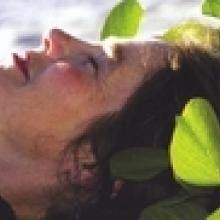 photo of Joanne Rand lying in the green leaves