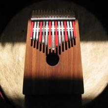 photo of a kalimba sitting atop a drum