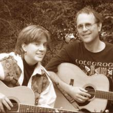 photo of Peter and Annie with their guitars