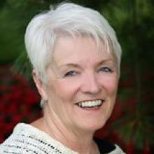 photo of Sandy McKinney smiling