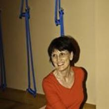 photo of Sandra Helpsmeet smiling and leading a Yoga class
