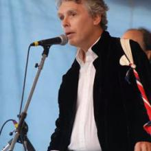 photo of David Massengill singing at the microphone